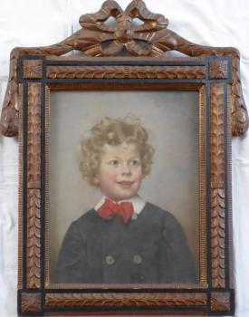 Portrait of a boy with a ribbon